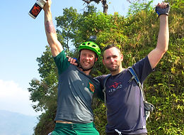 Two mountain bikers celebrating after their ride in Nepal