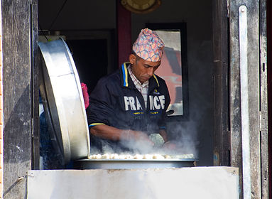 Man cooking delicious momos in Bhaktapr, Nepal
