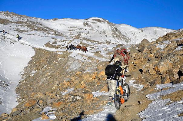Mountain Bike rider climbing pass, Nepal