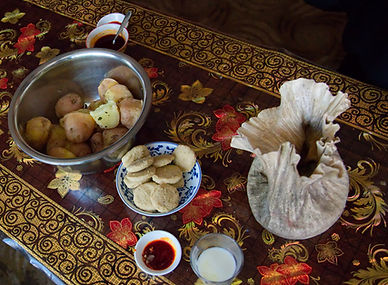 A village meal of Tsampa and potatoes in rural village, Tibet