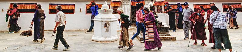 Old Tibetan women and men walking the Kora around Boudhanath Stupa, Kathmandu, Nepal