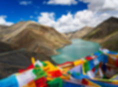 Prayer flags over lake at Karo Pass, Tibet