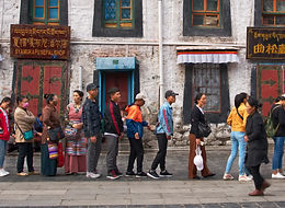 Queue around the Barkhor, waiting to enter the Jokhang Temple, Lhasa, Tibet