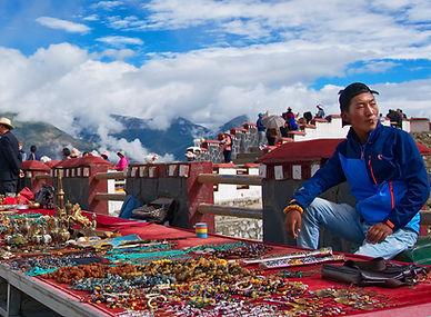 Trader with wares at Khamba Pass, above Yamdrok-tso Lake, Tibet
