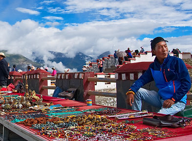 Trader with wares at Khamba Pass, above Yamdrok-tso Lake, Tibet