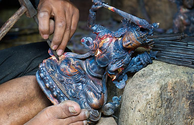Cleaning wax cast statue, Bungamati, Nepal