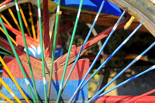 Colourful spokes of a rickshaw in Kathmandu, Nepal