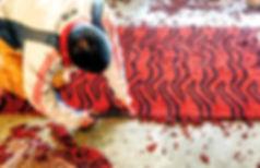 Man trimming a completed Tibetan carpet.  Patan, Nepal