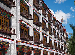 Decorated windows of building near the Barkhor in Tibet