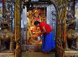 Nepalese woman caretaking the shrine at Golden Temple, Patan, Nepal