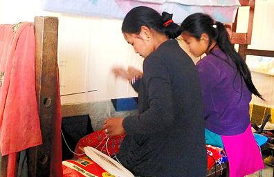 Two nepalese women weaving a Tibetan Carpet, Patan, Nepal