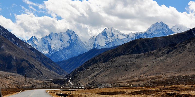 A road heading off into the mountains in Tibet.