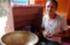 Craftsman engravng inside of hand made singing bowl in Bungamati, Kathmandu, Nepal