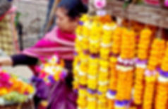 Nepalese woman selling garlands in Kumbeshwar Temple, Patan, Nepal
