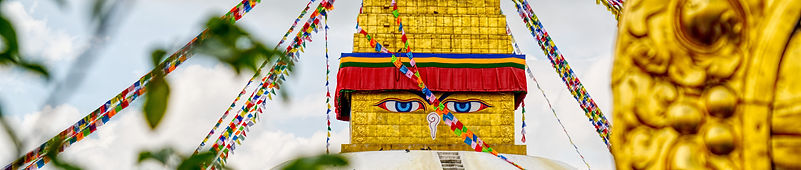 View of eyes on the Boudhanath Stupa from temple rooftop
