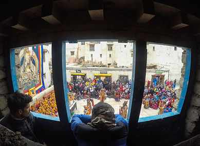 Watching Tiji festival from window, Lo-Manthang, Upper Mustang, Nepal