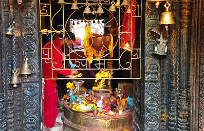 Monk performing offering in The Golden Temple, Patan, Nepal