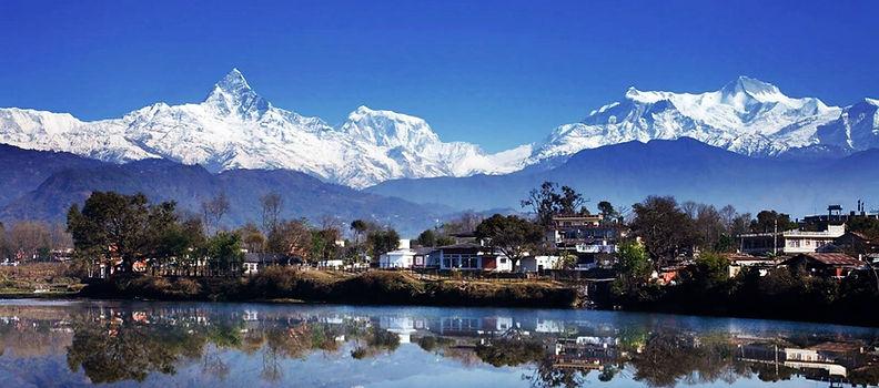 Reflections of Pokhar and mountains on Phewa Lake, Annapurna, Nepal