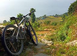 Mountain bike resting against a fence in Annaupurna region, Nepal