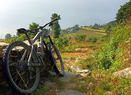 Mountain bike resting against a fence in Annaupurna region, Nepal