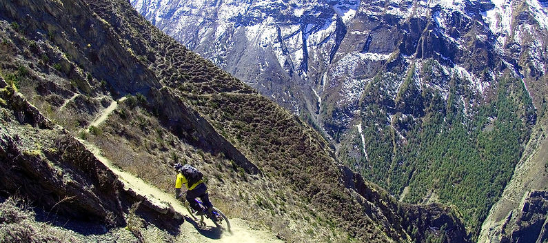 Mountain bike racing downhill in Mustang Nepal