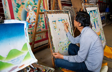 Nepali man painting a Thangka in workshop in Boudhanath, Kathmandu, Nepal