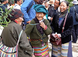 Elderly Tibetan woman enjoying the Shoton Festival at Drepung Monastery near Lhasa, Tibet