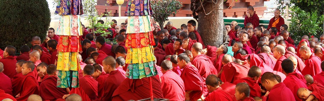 Buddhist monks listening to lesson in courtyard of Kopan Monastery, Nepal