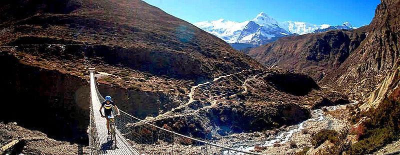 Cycling suspension bridge leaving Manang, Annapurna, Nepal