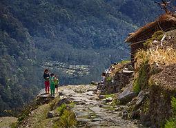 Children standing on mountain trail in Annapurna Region, Nepal