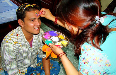 A Nepalese woman making offering to her brother