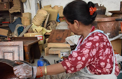 Nepalese woman creating handicrafts