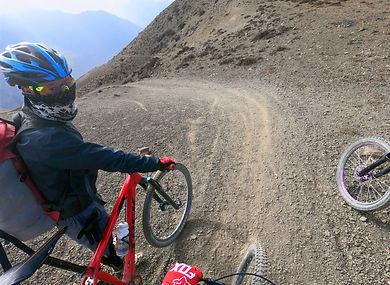 Mountain bike rider at top of trail in Upper Mutstang, Nepal