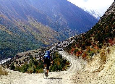 Cyclist riding down trail, Annapurna, Nepal