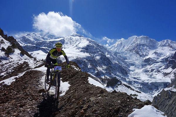 Mountain Bike rider in snow, Yak Attack, Nepal