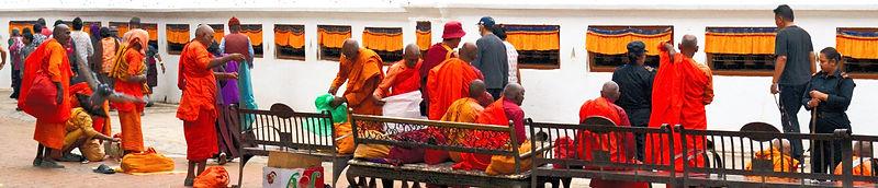 Group of Buddhist Monks standing around Boudhanath Stupa, Kathmndu, Nepal