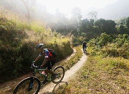 2 mountain bike riders on open trail in Nepal