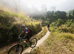 2 mountain bike riders on open trail in Nepal