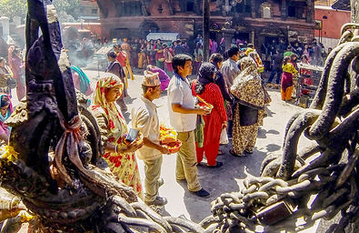 Nepalese people lined up to receive blessings at Kumbewshwar Temple, Patan, Nepal