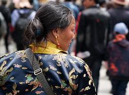 Tibetan woman dressed up forShoton Festival at Drepung Monastery near Lhasa, Tibet