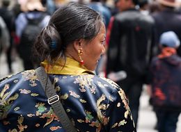 Tibetan woman dressed up forShoton Festival at Drepung Monastery near Lhasa, Tibet