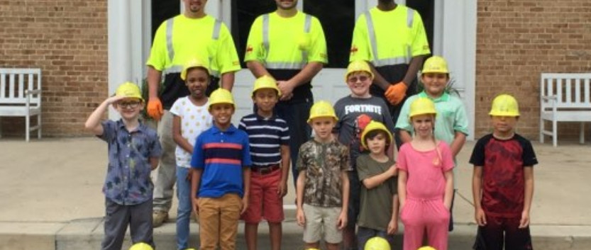 UMA technicians Dwayne Maloney, David Frazier & Eric Gilbert pose with some of our elementary students in their hard hats!