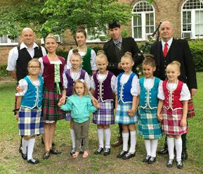 Our friends from Roland's Dance studio and (centre back) Peter McArthur, our school piper.