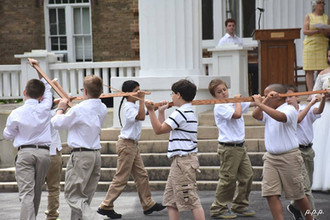 Mrs. Duncan supervises the Longsword Dance from the front portico.