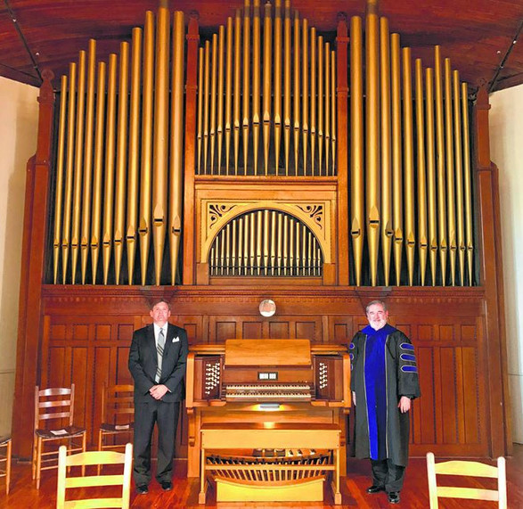 Alex Watson and Mark Andersen with the newly restored organ.