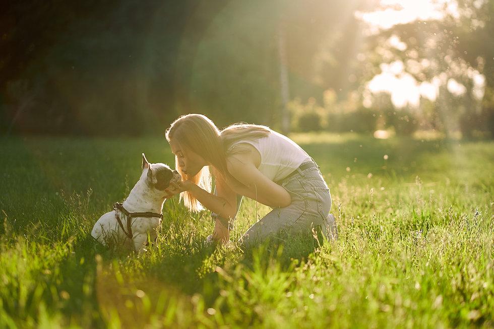 happy-young-woman-kissing-french-bulldog-park.jpg