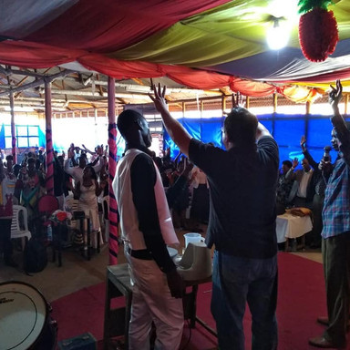 The Nissi Project Church Service Men Raising Hands in Prayer