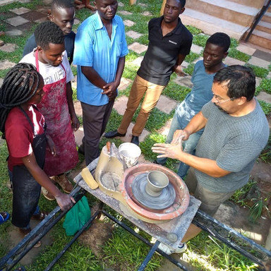 Nolan Windholtz teaching pottery at The Nissi Project