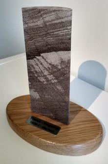 Half cut core on plinth