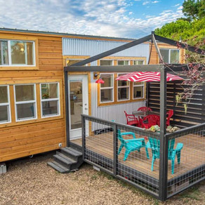 Beautiful 28' Tiny House, features a side entry.